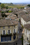 roofs of buildings of saint-emilion at overcast day. poster