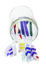 Toothbrushes in Glass Jar on White Background