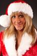 Portrait Weihnachtsfrau mit Nikolausmütze