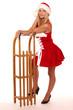 Leinwanddruck Bild - Weihnachtsfrau sitzt auf Schlitten