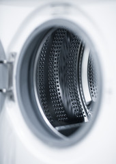 Washing machine with interior view of a washing drum.