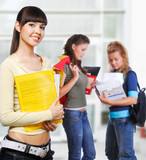 Clever student holding yellow folder in hands poster