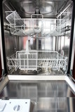 new dishwasher in a kitchen.... poster