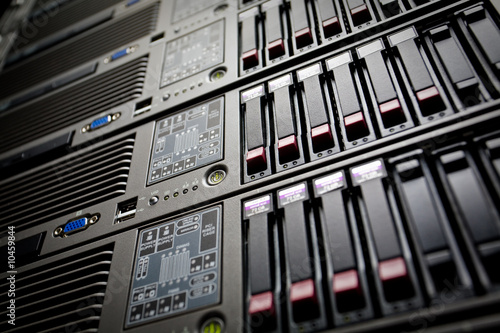 Servers stack with hard drives in a datacenter rack