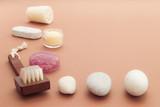 bath items including sea salt brush loofah algae soap stones poster