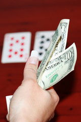 hand of the girl with card for game of poker