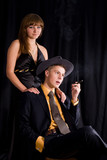 An image of woman and man with cigar