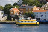 small boat near coastal Norwegian village poster