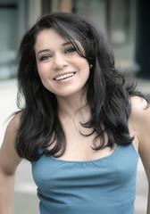 casual hispanic businesswoman smiling