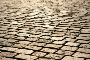 Stone pavement of a town reflecting the light of the setting sun