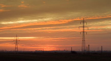 Industrial landscape: powerlines at dusk