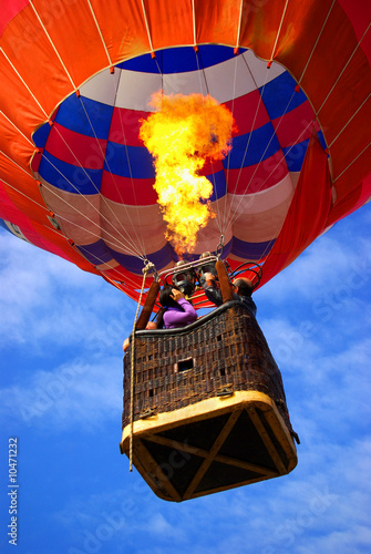 Leinwandbild Motiv Colorful hot air balloon with bright burning flame