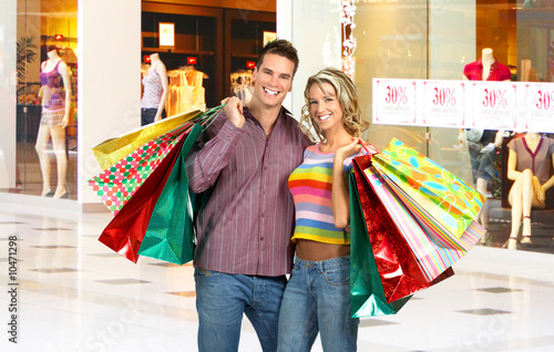 Shopping smiling couple in the mall.
