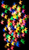 Colorful bokeh of christmas lights stars poster