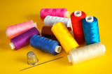 sewing.thread coils, thimble and a needle poster
