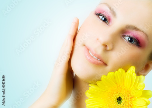 Beautiful woman with gerbera flower.