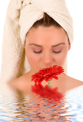 Beautiful spa woman with flower.