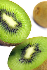 Kiwi halves over white background