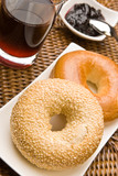 Fresh bagels with jam and blackcurrant juice