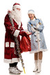 Smiling snow maiden and Santa Claus with gifts