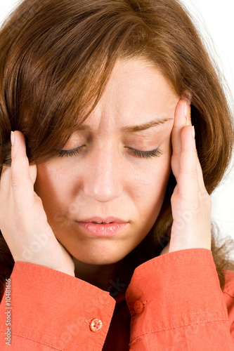 Young woman with migraine isolated on white background