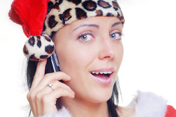 Woman in Santa Claus costume talking via mobile phone