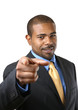 Handsome African American businessman pointing finger at viewer.