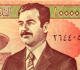 Saddam Hussein on 10,000 dinars banknote from Iraq