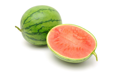 Fresh watermelon halved in isolated white background