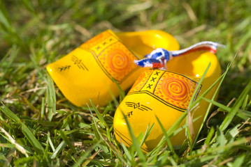 Dutch yellow wooden shoes outdoor in the grass