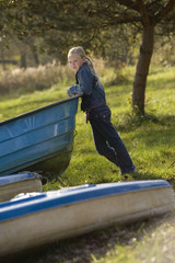Little girl standing in the boat