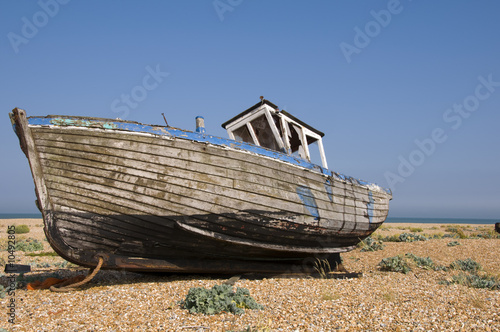 An old fishing boat on the beach at Dungeness