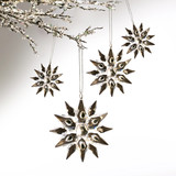 Silver snowflakes hanging against pale grey background poster