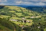 Village in Welsh valley poster