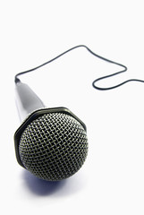 View of an usual microphone isolated over a white background.