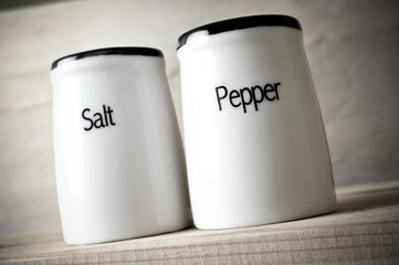 Toned photo of saltshaker and pepper pot, taken from below