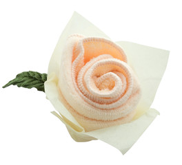 Pink rose done from towel isolated on white