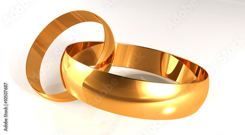 Wedding gold rings on the light background, being nearby