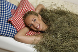Young woman, portrait, hay bath