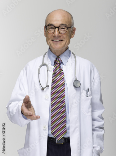 Senior male doctor gesturing, portrait