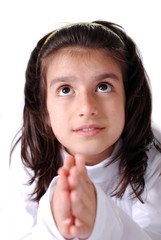 A girl praying and looking upwards with expectance from above