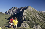 Austria, Salzburger Land, three people hiking in the alps