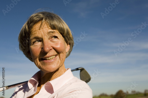 Senior adult woman holding golf club
