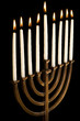 Beautiful lit hanukkah menorah isolated on black.