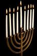 Beautiful lit hanukkah menorah isolated on black.