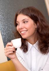 beautiful caucasian girl drinking hot coffee