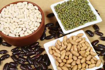 Four sorts of beans in ceramic bowls. Cuisine composition.