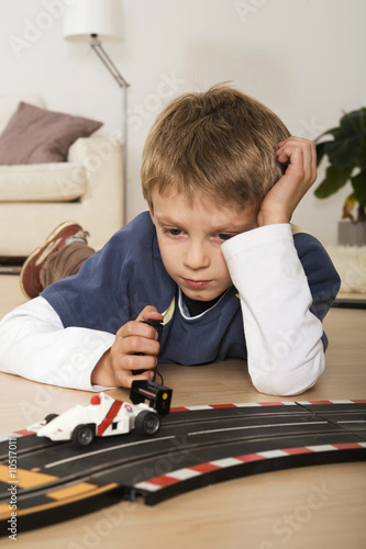 Child (7-9) playing with toy car