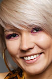 portrait of young smiley blond with piercing in eyebrow poster