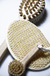 Massage brush, peeling massage brush and loofah scrub, close-up